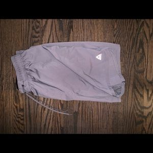 2 pairs of training shorts Under Armour and Reebok